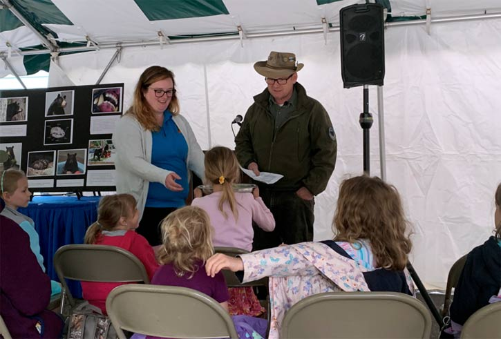 hez Hill and Murray Clark engage Daisy Scouts during the Bear Facts presentation
