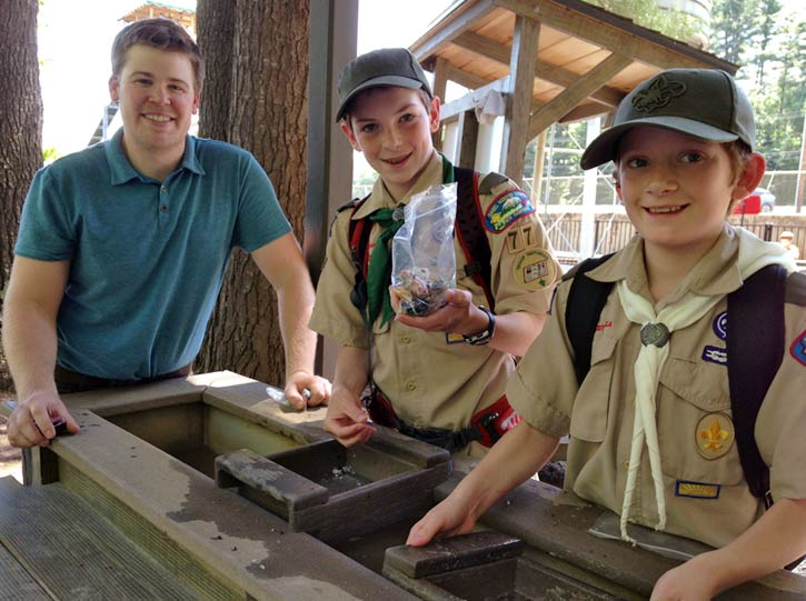 Boy Scouts mining for gemstones and fossils with Chris Englert during Geology presentation